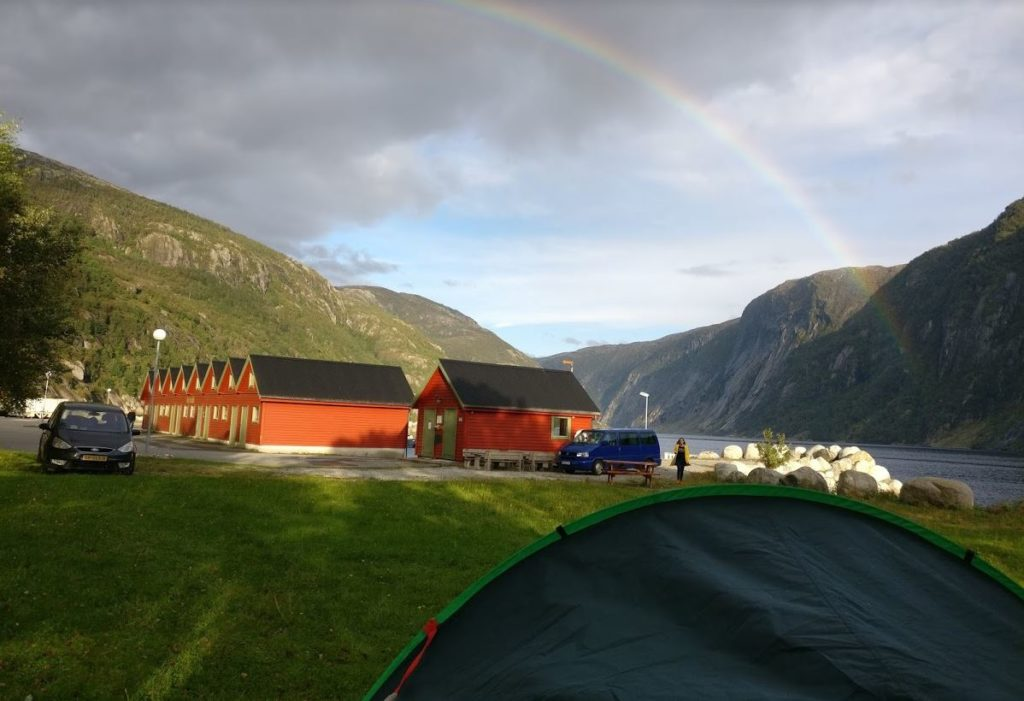 beautiful rainbow while wild camping near fjord